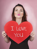Woman holds big red heart i love you in her hands Stock Photos