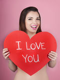 Woman holds big red heart i love you in her hands Royalty Free Stock Image