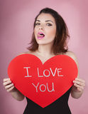 Woman holds big red heart i love you in her hands Royalty Free Stock Photos