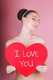 woman holds big red heart i love you in her hands Stock Images