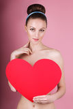 woman holds big red heart i love you in her hands Royalty Free Stock Images