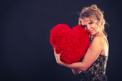 Woman holds big red heart love symbol Stock Images