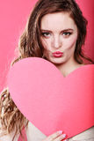 Woman holds big red paper heart Stock Photos