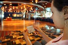Woman holds bingo card Royalty Free Stock Photos