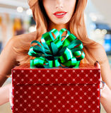 Woman holds the a birthday red gift  box Stock Image