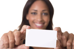 Woman holds a blank business card. Blank business card is in focus while model is out of focus in background Stock Photos