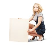 Woman holds blank canvas Stock Photo
