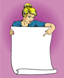 Woman holds blank white paper poster. Pop art comic retro style vector illustration. Put your own text template.  Royalty Free Stock Images