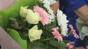 Woman holds bouquet of multicolor flowers stock footage