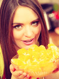 Woman holds bowl full of sliced orange fruits Royalty Free Stock Images