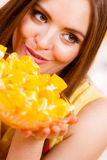 Woman holds bowl full of sliced orange fruits Royalty Free Stock Photos