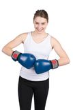 Woman holds boxing gloves against each other Royalty Free Stock Photos