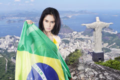 Woman holds Brazilian flag at the city Stock Images