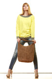 Woman holds brown fringe handbag Royalty Free Stock Photos