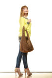 Woman holds brown fringe handbag Stock Photo