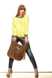 Woman holds brown fringe handbag Royalty Free Stock Image