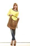 Woman holds brown fringe handbag Stock Photo