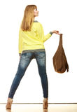 Woman holds brown fringe handbag Royalty Free Stock Photography