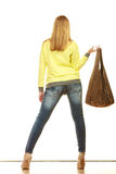 Woman holds brown fringe handbag Royalty Free Stock Images