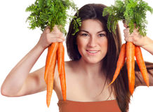 Woman holds bunch of carrots Stock Photos