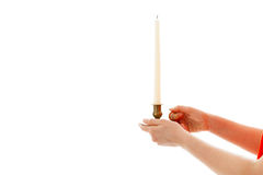 The woman holds a candle in hands Stock Image