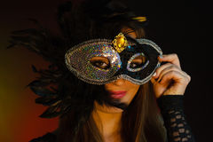 Woman holds carnival mask closeup Stock Image