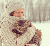 Woman holds a cat on nature Stock Photography