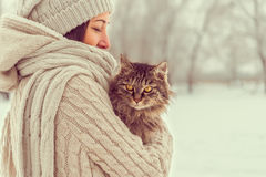 Woman holds a cat Royalty Free Stock Image