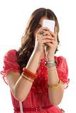 Woman holds a cell phone. Royalty Free Stock Image