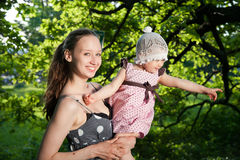 Woman holds child Stock Photography