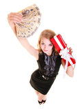 Woman holds christmas gift box and polish money. Holidays. Stock Photography