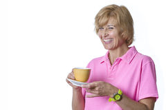 Woman holds a coffee cup smiling. Woman holds coffee cup with a big smile Stock Images