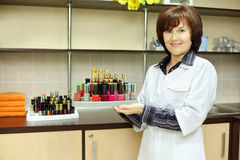 Woman holds colored nail polish Royalty Free Stock Photography