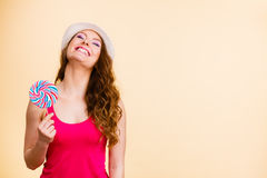 Woman holds colorful lollipop candy in hand Royalty Free Stock Photo