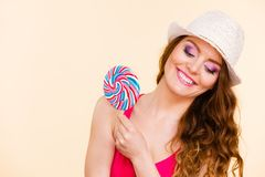 Woman holds colorful lollipop candy in hand Stock Image
