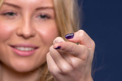Woman holds a contact lens Royalty Free Stock Photography