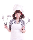 Woman holds a cooking spoon Royalty Free Stock Images