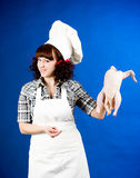 Woman holds a Crude hen Stock Photo