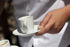 Woman holds cup for coffee Stock Image