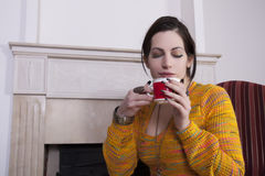 Woman holds a cup of coffee. Portrait of woman holding a cup of coffee royalty free stock images