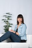 Woman holds a cup of coffee Stock Photography