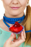Woman holds cupcake trying to resist temptation Stock Images