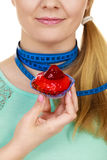 Woman holds cupcake trying to resist temptation Stock Photography