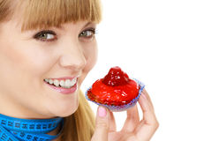 Woman holds cupcake trying to resist temptation Stock Photo