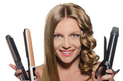 Woman holds curling iron. Young woman with  smile holds curling iron Stock Images