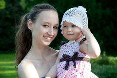 Woman holds daughter Stock Image