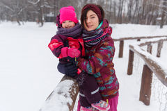 Woman holds daughter in winter Royalty Free Stock Image