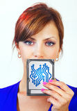 Woman holds digital device Stock Photos