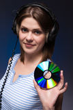 Woman holds disc Royalty Free Stock Photos