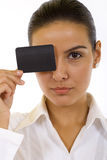 Woman holds an empty business card. Over one eye. It is ready to your inscription Stock Images